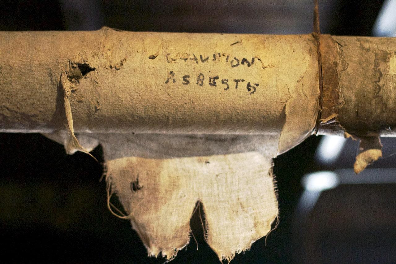 Asbestos Written on pipe